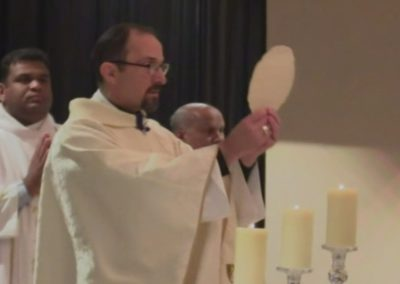Bishop Bartosic Holding Eucharist